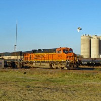 BNSF ES44AC 6072 leading SB coalie across UP and BNSF's ex-FW&D diamond