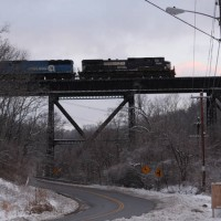NS9288 leading Southbound grain train over Devou trestle, Ludlow, KY, 1-30-