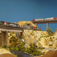 050521 (n scale) An SP manifest passes under a Santa Fe hotshot