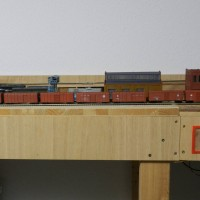 Resin boxcars painted but not finished