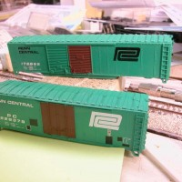 Workbench Two Penn Central Boxcars in Progress
