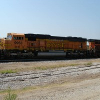"BNSF SD70MAC 9953 (so-called ""Chili Mac""), Verdigris siding, betw"