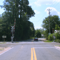 6 gate crossing on small highway