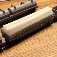 50 foot Flat Car with load of pipes. all 3D printed in z scale