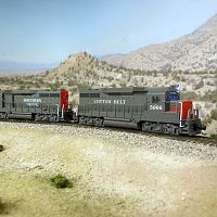 A pair of Southern Pacific GP30's pull a freight through the Nevada desert
