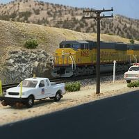UP freight passing some maintaince of way trucks near Battle Mountain, Nevada