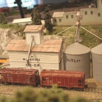 Sand Springs Railway - Muskogee Co-op is a building I scratchbuilt to provide a siding.  The Butler Tank names are made from different size dry transfers