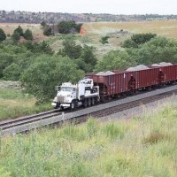 BNSF MOW Truck pulling (or being pushed?) three ballast cars downgrade on the Curtis Hill, OK, Transcon line:  Aug 2009