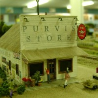 Scratchbuilt Purvis Store on the club's traveling layout. Purvis Store sign, groceries sign and gas decal on roof are homemade.