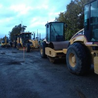A line of heavy equipment waiting to rework the right of way in Petaluma, Ca.