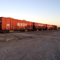 A cut of gons filled with ballast were parked on the NWP track near where I work in Petaluma, Ca.