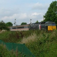 Class 47 on a Skegness special passing Sleaford West