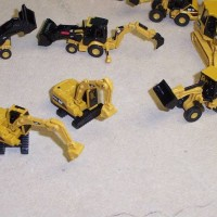 Close up of the 4 types of Caterpillar construction equipment vehicles