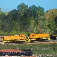 G and W MP15s pulling scrap into Keystone Siding