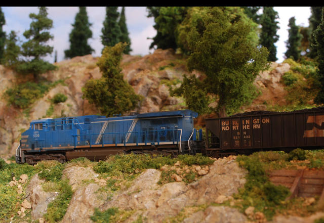 AC 4400 CEFX in the wild part of the layout.