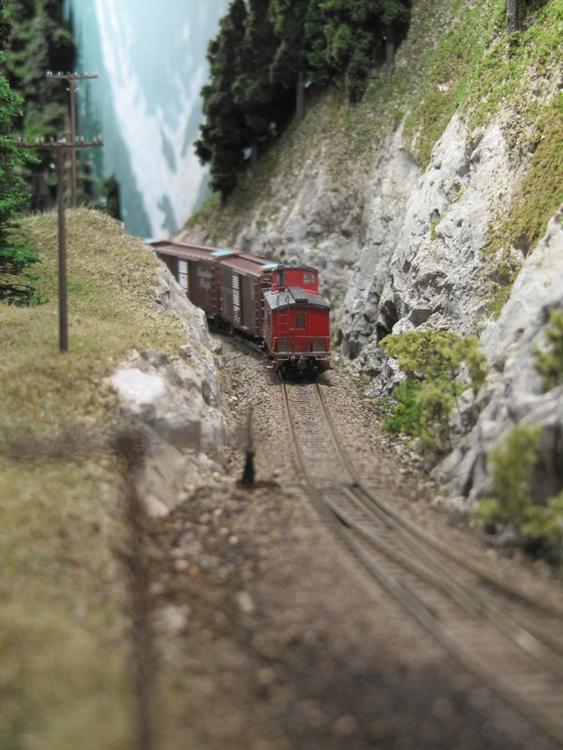 Approaching slide bridge.  Caboose by Jeff Briggs