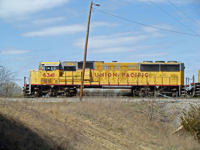 badly-faded UP SD60M, Ray Yard, Denison, TX