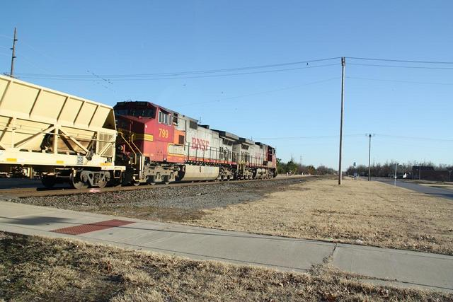 Couple of great looking WB Dash-9s pulling a string of dump cars_12 20 09_Norman, OK