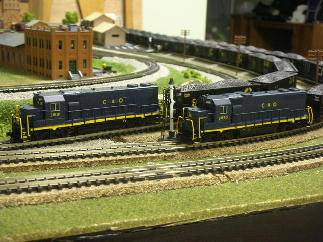 Custom painted Atlas C&O GP38's. I couldn't find any C&O GP38's so I painted my own and those are real road numbers used by C&O. I used an air brush water based paint with dullcote laquer to finish it off.