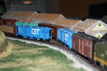 Here is a closeup of my freight cars parked in front of my lumber company.