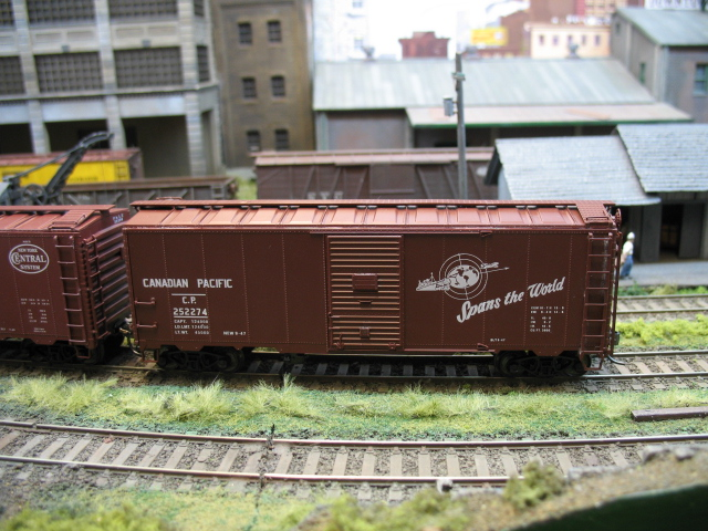 Intermountain and Red Caboose AAR boxcars