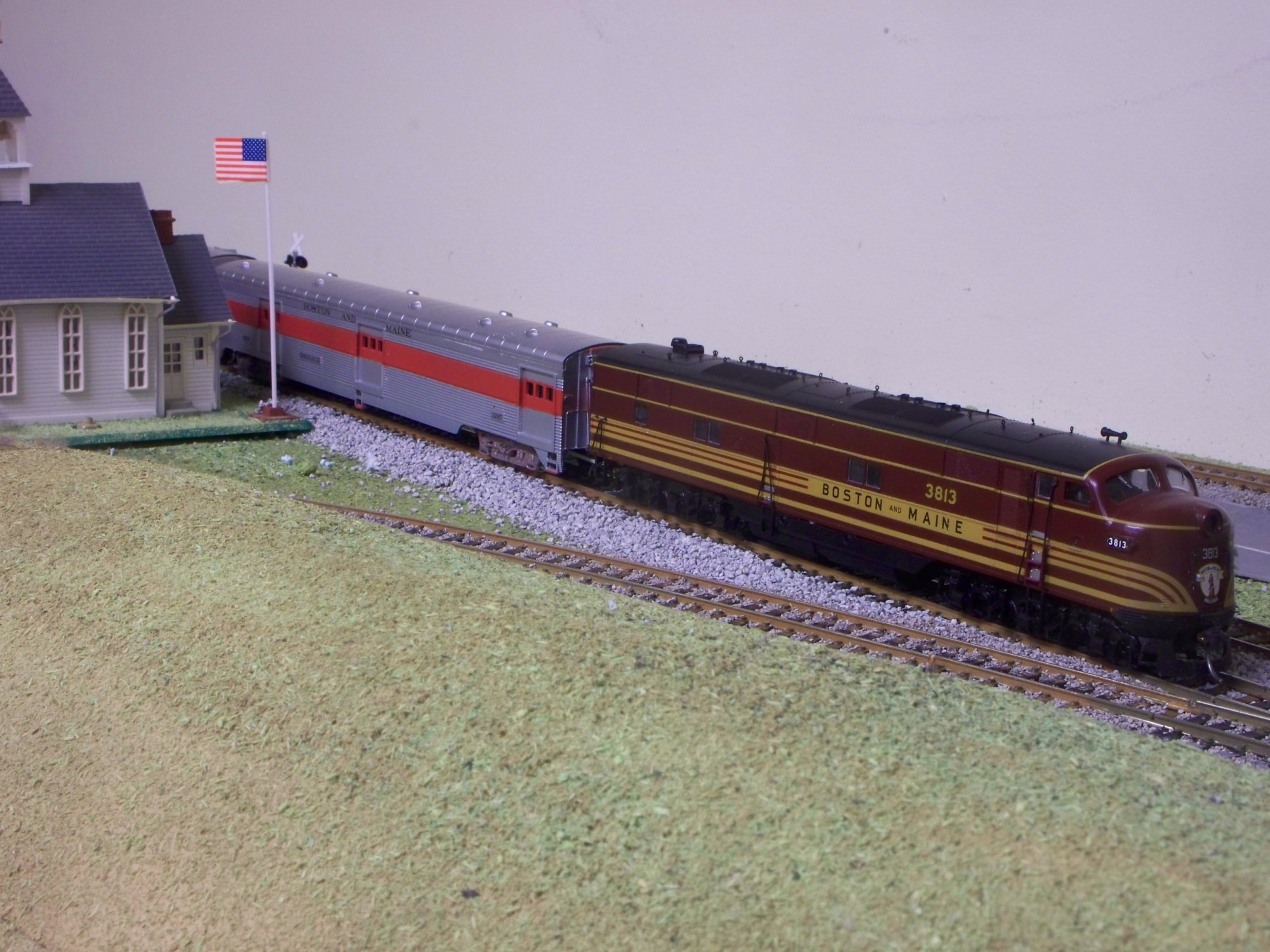 Proto2000 E unit leads train of IHC streamliners