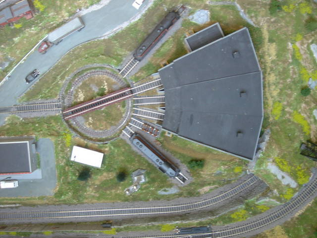 Turntable/Roundhouse diions - Model Railroader Magazine ... on railroad shops, on30 track plans, walthers track plans, 4x8 ho track plans, railroad roundhouses chicago, railroad yards in chicago, railroad structure plans, lionel train track layout plans, o gauge turntable plans, railroad water tower plans, railroad roundhouses missouri, railroad engine shed plans, ho scale turntable plans, railroad yard design, railroad turntable, railroad stations, railroad tracks, railroad roundhouses in ohio,