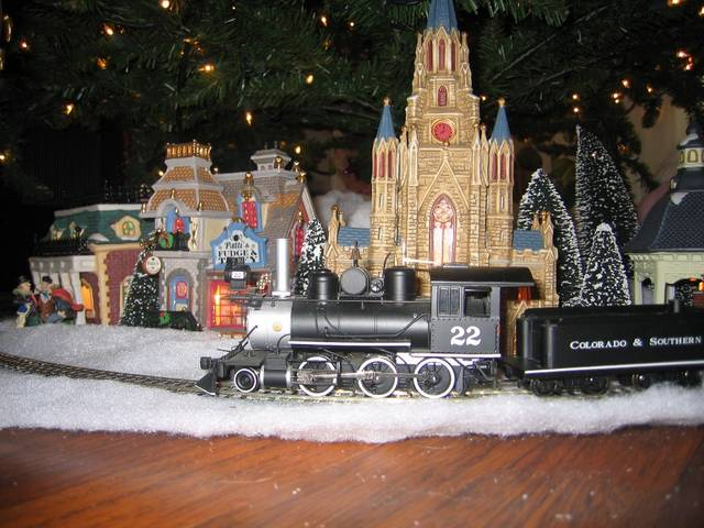 Trains Around The Christmas Tree Part - 29: This Is One From A Couple Of Years Ago. Its A Bmann On30 Set And Some Of  The Cheap Ceramic Buildings From Wally World