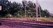 91-05_30_At-grade_rr_xng_gate_for_trains_somewhere_near_Advance-MO_a.jpg