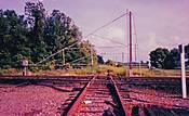 91-05_30_At-grade_rr_xng_gate_for_trains_somewhere_near_Advance-MO_b.jpg